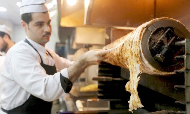 Traditional delicacies. A Syrian man work at a Syrian restaurant in 6 October City in Giza. (Reuters)