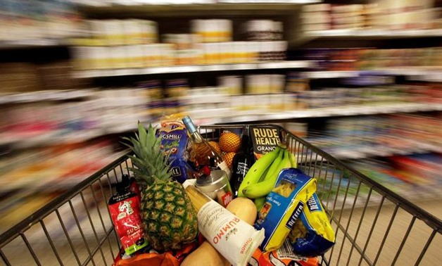 A shopping trolley is pushed around a supermarket - Reuters