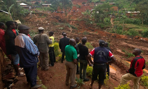 People gather at the site of a landslide caused by heavy rains in the town of Bafoussam in the western highlands, Cameroon October 30, 2019. REUTERS/Stringer