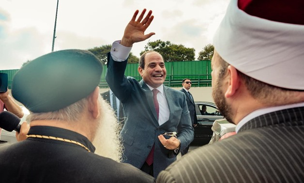 File- Egyptian President Abdel Fatah al Sisi saluting Egyptians at the Cairo International Airport