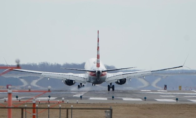 FILE PHOTO: An American Airlines Boeing 737 MAX 8 flight from Los Angeles lands at Reagan National Airport shortly after an announcement was made by the FAA that the planes were being grounded by the United States in Washington, U.S. March 13, 2019. REUTE