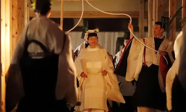 Japan's Emperor Naruhito walks to Yukiden to attend 'Daijosai', the most overtly religious ceremony of the emperor's accession rituals, at the Imperial Palace in Tokyo, Japan, November 14, 2019, in this photo released by Kyodo. Mandatory credit Kyodo/via