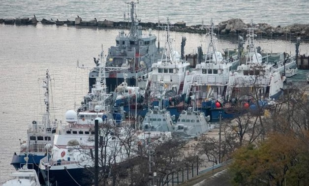 Seized Ukrainian naval ships are guarded by Russia's Coast Guard vessels in the port in Kerch, near the bridge connecting the Russian mainland with the Crimean Peninsula, Crimea November 17, 2019. REUTERS/Alla Dmitrieva