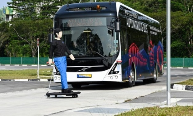 A Volvo AB 7300 electric autonomous bus drives on the track of Center of Excellence for Testing & Research of Autonomous Vehicles after being launched in Singapore- AFP