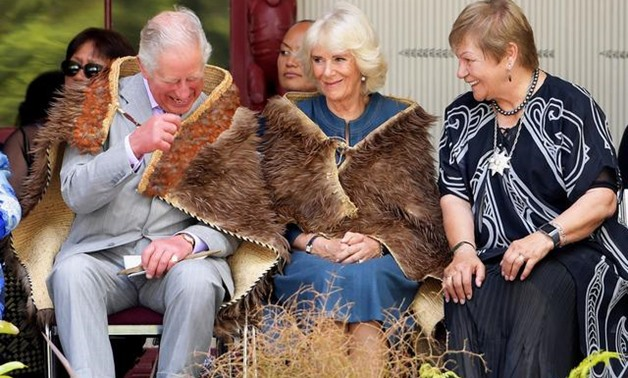Prince Charles and his wife Camilla, the Duchess of Cornwall wear traditional cloaks as Dame Nadia Galvish translates the local Chiefs' speeches during a visit to Waitangi Treaty Grounds in Waitangi, New Zealand November 20, 2019. REUTERS/Tracey Nearmy