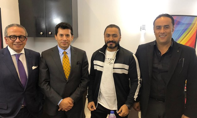 (From right to left) Presentation Company head Montasser el Nabarawy, singer Tamer Hosny, and other representatives pose for a picture- press photo