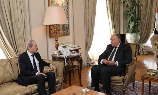 FILE- Egyptian Foreign Minister Sameh Shoukry meets with his Jordanian counterpart Ayman Safadi at the Arab League headquarters in Cairo on November 25, 2019- press photo