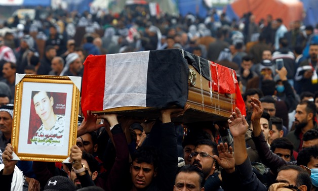 Mourners carry the coffin during the funeral of a demonstrator who was killed at an anti-government protest overnight in Najaf, Iraq November 29, 2019. REUTERS/Alaa al-Marjani
