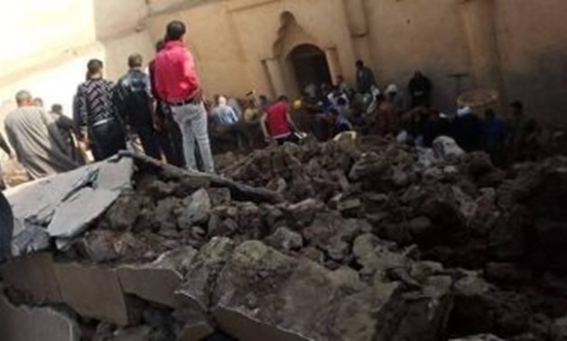 Civil protection forces on Sunday managed to retrieve three        bodies from the rubble of a collapsed wall inside an ancient        monastery in Upper Egypt's Minya - Press photo