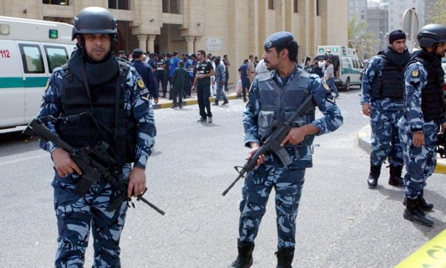 Kuwaiti security forces father outside the Shi'ite al-Imam al-Sadeq mosque in Kuwait City after it was targeted by a suicide bombing during Friday prayers on June 26, 2015 (AFP)