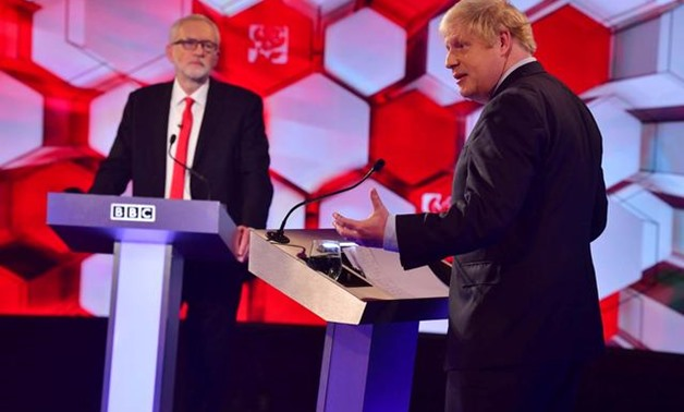 Britain's Prime Minister Boris Johnson and opposition Labour Party leader Jeremy Corbyn face each other in a head-to-head debate on the BBC in London, Britain December 6, 2019. Jeff Overs/BBC/Handout via REUTERS