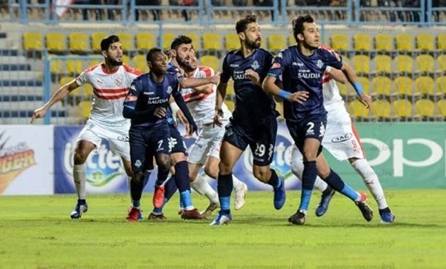 File-  players battle for the ball during a game between Zamalek and Pyramids last season