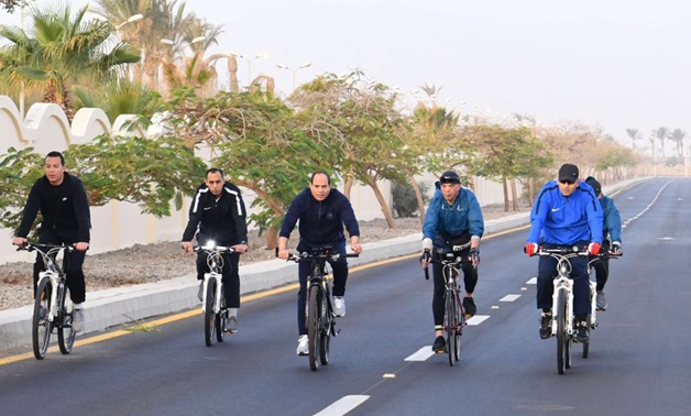 President Abdel Fatah al-Sisi went on a bike tour on Saturday in the Red Sea city of Sharm el Shiekh on the sideline of the World Youth Forum - Press Photo
