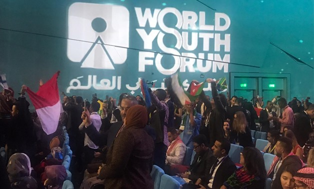 Participants in WYF 2019 waving the flags of their countries in the opening ceremony held in Sharm El Sheikh on December 14, 2019. Egypt Today
