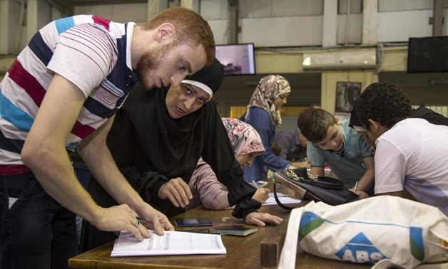 A Syrian refugee registers at UNHCR's office in Cairo, Egypt, in September 2016. © UNHCR/Scott Nelson