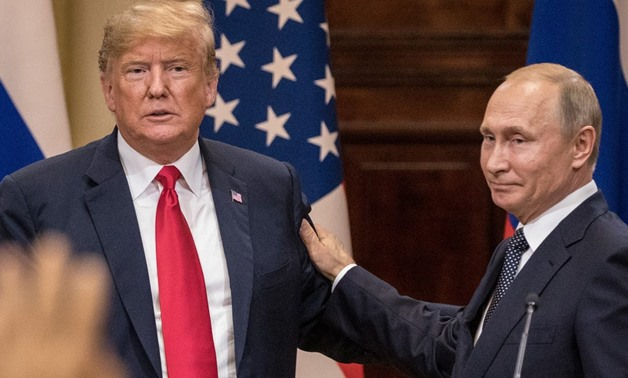 FILE: President Donald Trump and Russian President Vladimir Putin at their summit in Helsinki, Finland, in July. Chris McGrath/Getty Images