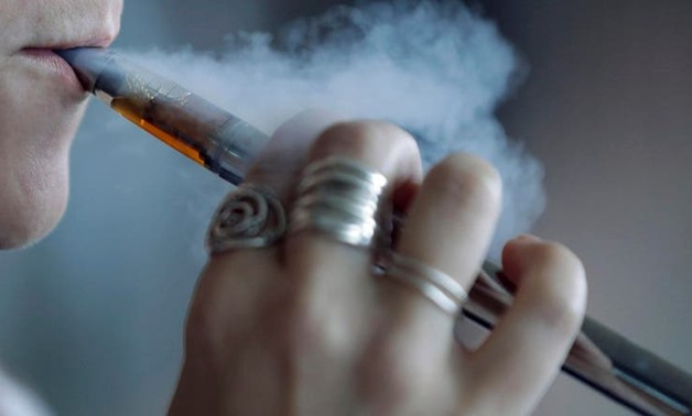 A woman using a vaping device exhales a puff of smoke in Mayfield Heights, Ohio. (File photo: AP)