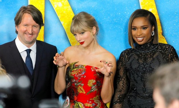 "FILE PHOTO: Director Tom Hooper, singer Taylor Swift and actress Jennifer Hudson arrive for the world premiere of the movie ""Cats"" in Manhattan, New York, U.S., December 16, 2019. REUTERS/Andrew Kelly"