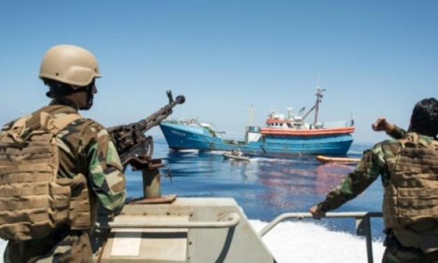 Libyan coastguards stand on an armoured boat as they patrol the sea off Libya's western coast. (AFP/File)