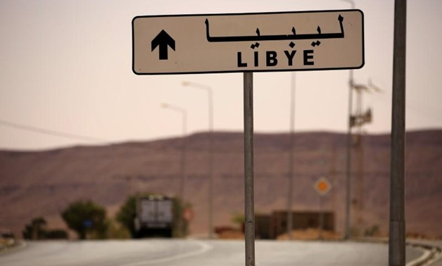 A road sign shows the direction of Libya near the border crossing at Dhiba, Tunisia April 11, 2016. REUTERS/Zohra Bensemra