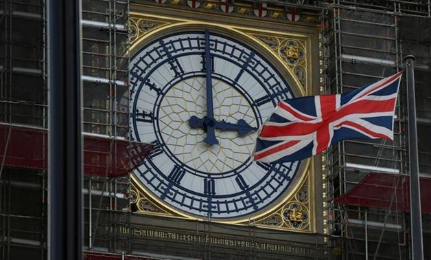 FILE PHOTO: British Union Jack flag flies in front of the clock face of Big Ben in London, Britain August 29, 2019. REUTERS/Toby Melville