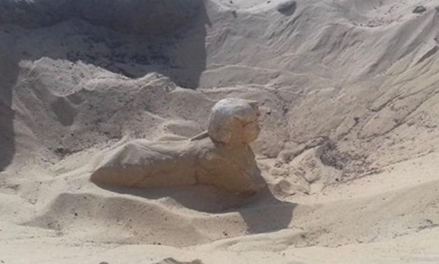 File- A small royal statue of a sphinx was uncovered in Tuna El-Gebel.