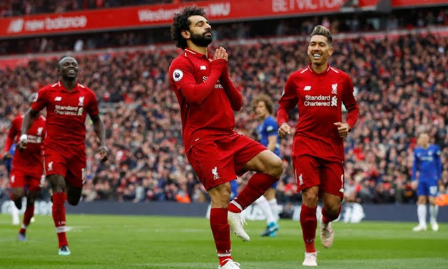 Salah celebrates scoring against Chelsea, Reuters