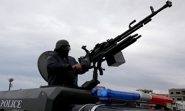 A member of the central security support force holds a weapon during the security deployment in the Tajura neighborhood, east of Tripoli, Libya December 30, 2019. REUTERS/Ismail Zitouny