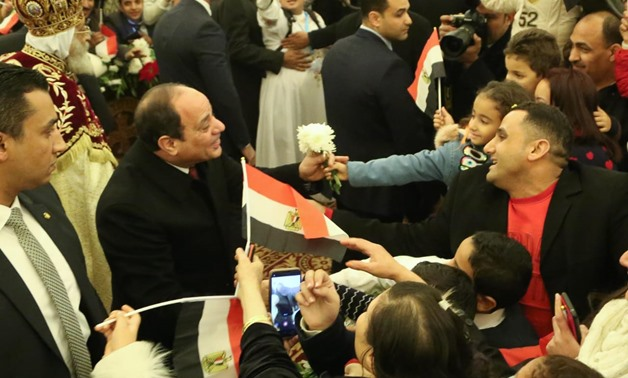 FILE- President Abdel Fatah al-Sisi receives warming reception from Coptic Christians at 2020 Christmas Eve mass at the Cathedral of the New Administrative Capital- Egypt Today/Karim Abdel Aziz