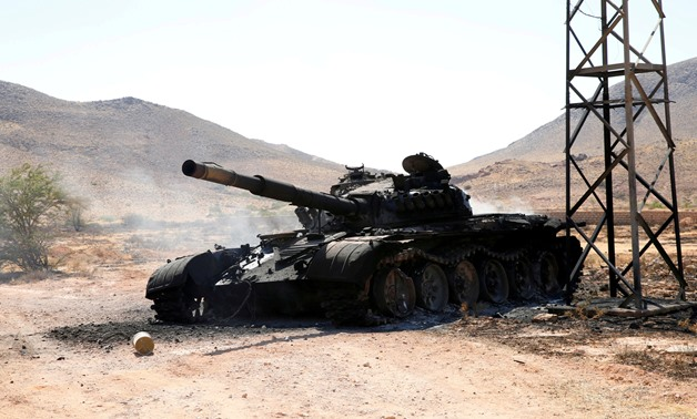 FILE PHOTO: A destroyed and burnt tank that belonged to the eastern forces led by Khalifa Haftar, is seen in Gharyan south of Tripoli Libya June 27, 2019. REUTERS/Ismail Zitouny/File Photo