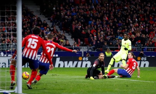 Soccer Football - La Liga Santander - Atletico Madrid v Barcelona - Wanda Metropolitano, Madrid, Spain - November 24, 2018 Barcelona's Ousmane Dembele scores their first goal REUTERS/Paul Hanna