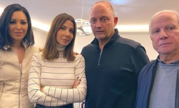 Nancy Ajram and her husband Fadi al-Hashem in the middle