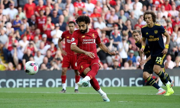 Soccer Football - Premier League - Liverpool v Arsenal - Anfield, Liverpool, Britain - August 24, 2019 Liverpool's Mohamed Salah scores their second goal from the penalty spot Action Images via Reuters/Carl Recine