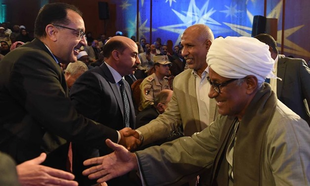 Prime Minister Mostafa Madbouli on Monday attended a celebration in Upper Egypt's Aswan to pay Nubian people the compensation they deserve, as they were displaced by the construction of the two Aswan dams since 1902 - Courtesy of the Council of Ministers
