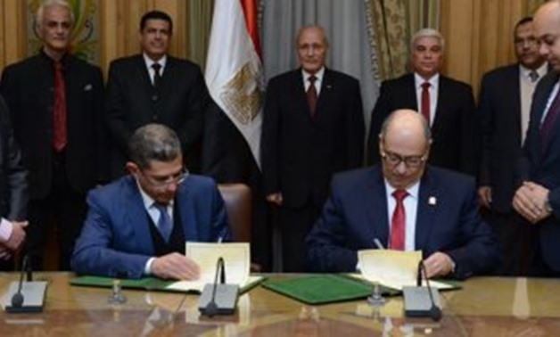 Military Production Minister Mohamed Saeid el Assar witnessed the signing of a protocol of cooperation between the Egyptian Academy for Engineering and Advanced Technology (EAE&AT) and Zewail City of Science and Technology - Press Photo