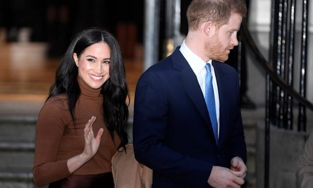 FILE PHOTO: Britain's Prince Harry and his wife Meghan, Duchess of Sussex, leave Canada House in London, Britain January 7, 2020. REUTERS/Toby Melville