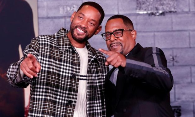 """FILE PHOTO: Cast members Will Smith (L) and Martin Lawrence pose at the premiere of """"Bad Boys for Life"""" in Los Angeles, California, U.S., January 14, 2020. REUTERS/Mario Anzuoni/File Photo"""