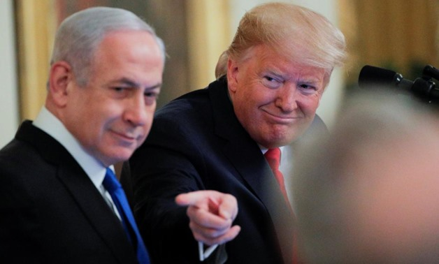 U.S. President Donald Trump points past Israel's Prime Minister Benjamin Netanyahu as they discuss a Middle East peace plan proposal during a joint news conference in the East Room of the White House in Washington, U.S., January 28, 2020. REUTERS/Brendan
