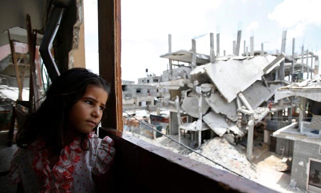A Palestinian girl stands in a damaged building - photo courtesy of UN official website