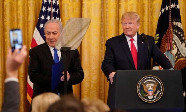 US President Donald Trump and Israel's Prime Minister Benjamin Netanyahu delivers joint remarks on a proposed peace plan proposal at the White House, Jan. 28, 2020 – Reuters