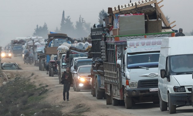A view of trucks carrying belongings of displaced Syrians, is pictured in the town of Sarmada in Idlib province, Syria, January 28, 2020. REUTERS/Khalil Ashawi