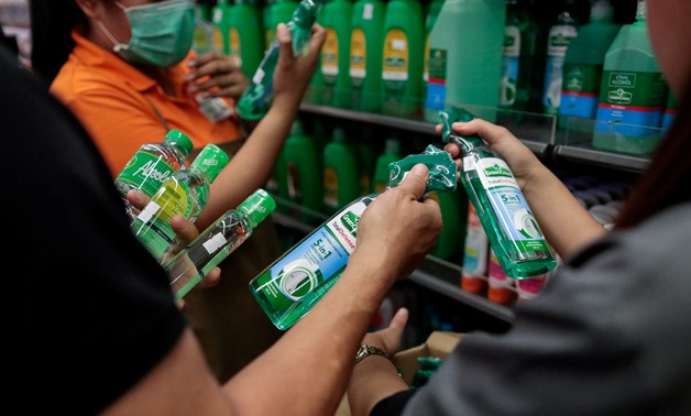 People hoard bottles of alcohol after the Philippine government confirmed the first case of the new coronavirus in the country, in Makati City, Metro Manila, Philippines, January 30, 2020. REUTERS/Eloisa Lopez