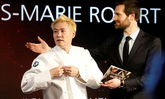 Newly awarded three-star Michelin chef Kei Kobayashi of Kei restaurant reacts on stage next to Gwendal Poullennec, International Director of Michelin Guides, during the Michelin Guide 2020 award ceremony in Paris, France, January 27, 2020. REUTERS/Charles