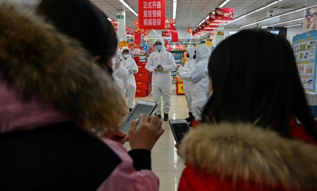 As of Saturday, almost 1,300 people have been infected across China, the bulk of them in and around Wuhan - AFP