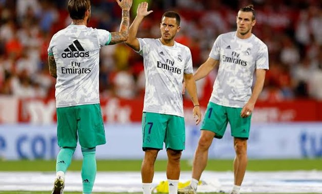 FILE PHOTO: Soccer Football - La Liga Santander - Sevilla v Real Madrid - Ramon Sanchez Pizjuan, Seville, Spain - September 22, 2019 Real Madrid's Gareth Bale, Eden Hazard and Sergio Ramos during the warm up before the match REUTERS/Marcelo Del Pozo/File