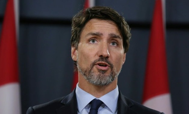 """Canadian Prime Minister Justin Trudeau's office said his overseas tour will focus on """"economic opportunity and prosperity, climate change, democracy, and gender equality"""" (AFP Photo/Dave Chan)"""