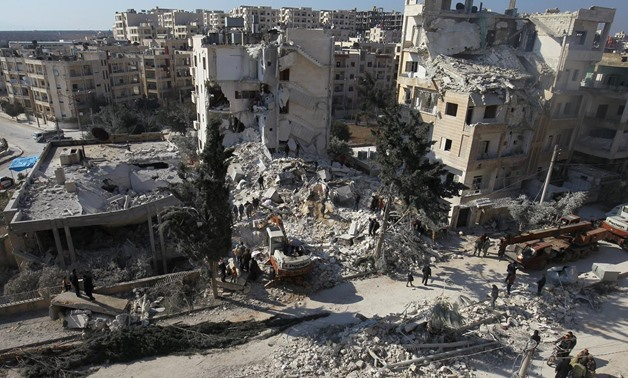 People inspect the damage at a site hit by airstrikes in the rebel-held city of Idlib, Syria February 7, 2017. REUTERS/Ammar Abdullah