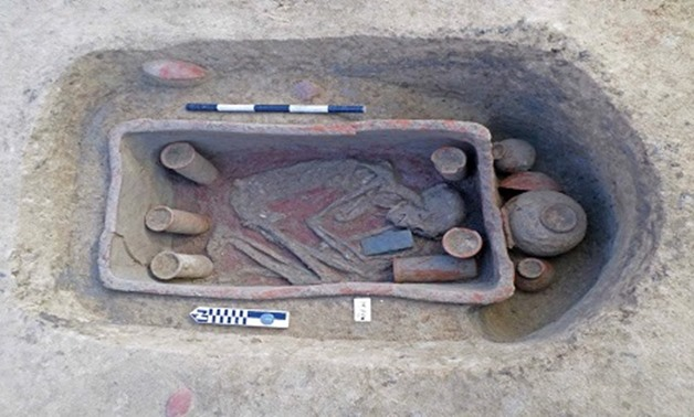 """One of the pottery tombs discovered in Egypt's Nile Delta region (Dakahliya governorate) with burials found in a """"squatting"""" poisition - Press photo"""