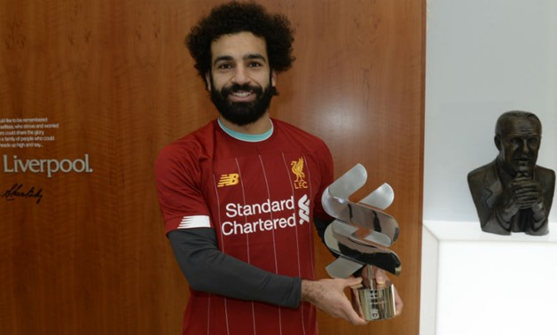 Salah holds the Player of the Month award, photo courtesy of Liverpool website