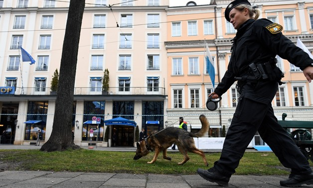 A police officer with a dog secures a street outside the venue of the annual Munich Security Conference in Munich, Germany February 14, 2020. REUTERS/ Andreas Gebert.
